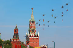Helicopters with flags fly over Red Square Royalty Free Stock Photos