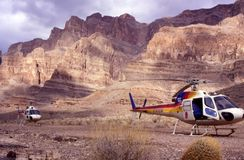 Helicopters on Grand Canyon National Park Floor. Adventure tourism travel stock photo