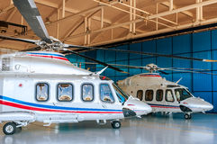 Helicopters in hangar. Two white helicopters in hangar Royalty Free Stock Image