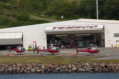 Helicopters. Ketchikan, AK, USA - May 24, 2016: Three helicopters based at Temsco Helicopters passenger terminal in Ketchikan, Alaska royalty free stock photo