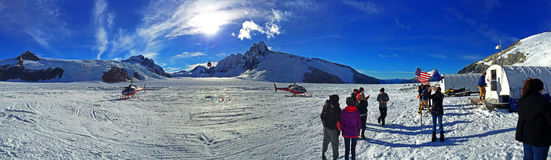 Helicopters landing on Mendenhall glacier. Mendenhall Glacier is a glacier about 13.6 miles long located in Mendenhall Valley, about 12 miles from downtown Royalty Free Stock Photo