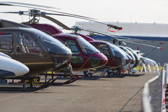 Helicopters lined up on the runway next to each other during the exhibition. No logos. Stock Photos