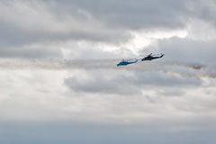 Helicopters MI-24 let out thermal traps and attack Royalty Free Stock Images