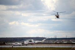 Helicopters of the Ministry of Emergency Situations of Russia at the Myachkovo airfield. MOSCOW, RUSSIA APRIL 27, 2018: Helicopters of the Ministry of Emergency royalty free stock photography