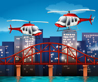 Helicopters near the bridge Royalty Free Stock Images