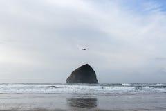 Helicoptor Flying Over Island. Helicoptor flying over beautiful island off the coast of Oregon in the USA Stock Image