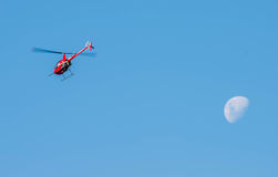 Helicoptor and the moon Stock Photos