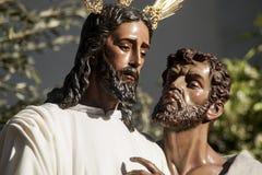 Helig vecka i Seville, Judas Kiss Royaltyfri Foto