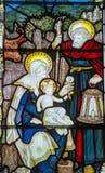 Heligt familjmålat glassfönster Fotografering för Bildbyråer