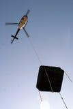 Helikopter met een pool Stock Afbeeldingen