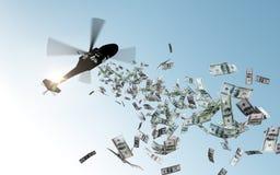 Helikopter som tappar pengar i himmel Arkivbilder