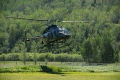 Helikopter tijdens de vlucht Jackson Hole Wyoming Stock Foto