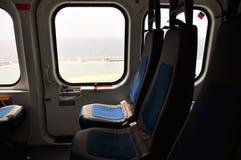 Helikopterinre och plats för passagerare, plats och säkerhetsbälte i inre av helikoptern Fotografering för Bildbyråer