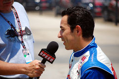 Helio Castroneves. Interviewed at the IZOD series Firestone Twin 275s Indy Car Race at Texas Motor Speedway in Pit Road Stock Photo