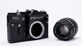 Old Soviet Zenit TLL 35 mm film camera isolated on white. With helios 44-2 lens Royalty Free Stock Images