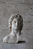 Helios statue. Bust of greek mythology sun god Helios. Broken marble statue of male figure at the ancient agora of Athens, Greece Stock Images