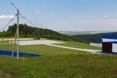 Helipad on the mountain in the resort city of Belokurikha in the Altai Krai. Belokurikha, Russia - July 30, 2015: Helipad on the mountain in the resort city of Royalty Free Stock Image