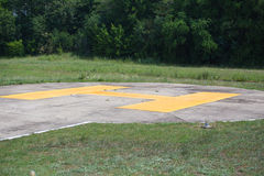Helipad. Sign on concrete airfield for helicopter Stock Images