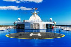 Helipad on upper deck of ship. Helipad for helicopter on the upper deck of big cruise ship Stock Photo