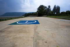 Heliport beside the lake under the blue sky. Royalty Free Stock Image