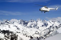 Heliski in high mountains Stock Photo