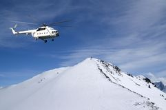 Heliski in snowy mountains Stock Photo