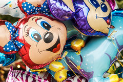 Helium baloon in  shape of Minnie Mouse. Helium baloon in the shape of Disney's character Minnie and other Disney characters Royalty Free Stock Photo