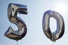 Helium sväller för 50th Fotografering för Bildbyråer