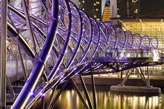 The Helix Bridge. Previously known as the Double Helix Bridge , is a pedestrian bridge linking Marina Centre with Marina South in the Marina Bay area in royalty free stock images