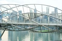 The Helix Bridge. Previously known as the Double Helix Bridge , is a pedestrian bridge linking Marina Centre with Marina South in the Marina Bay area in royalty free stock photo