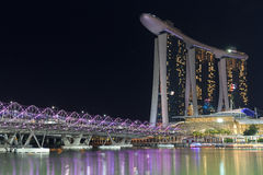 Helix bridge and hotel Marina Bay Sands in Singapore at night. Singapore, Singapore - May 18, 2015: Helix bridge and hotel Marina Bay Sands in Singapore at night Stock Photos