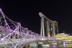 Helix bridge and hotel Marina Bay Sands in Singapore at night. Singapore, Singapore - May 18, 2015: Helix bridge and hotel Marina Bay Sands in Singapore at night Stock Images