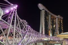 Helix bridge and hotel Marina Bay Sands in Singapore at night. Singapore, Singapore - May 18, 2015: Helix bridge and hotel Marina Bay Sands in Singapore at night Royalty Free Stock Images