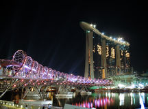The Helix bridge & Marina Bay Sands  Stock Images