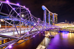 The Helix bridge with Marina Bay Sands in background Royalty Free Stock Photography