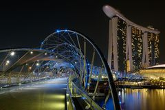 Helix bridge with Marina Bay Sands in background, Singapore Stock Images