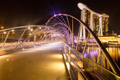 Helix Bridge and Marina Bay Sands. A view of the Helix Bridge connecting the city of SIngapore with the Marina Bay Sands hotel area royalty free stock photography