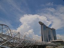 The Helix Bridge & MBS Singapore. Marina Bay Sands (MBS) Integrated Resorts and The Helix Bridge against beautiful sky & clouds Stock Photos