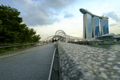 Helix Bridge   A picture to tells. Bayfront Avenue, Singapore - November 1, 2016: A group of Caucasian at the entrance of Helix Bridge to the venue of Marina Bay Stock Photos