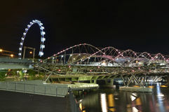 Helix Bridge and the Singapore Flyer Royalty Free Stock Photos