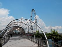 Helix Bridge & Singapore Flyer. The Helix Bridge against The Singapore Flyer. Ideal for writeup on Singapore's tourism industry Royalty Free Stock Photography