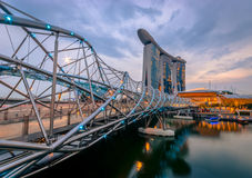 Helix Bridge - Singapore. The Helix Bridge just after sunset in Singapore City Stock Photos