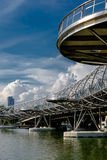 Helix Bridge at sunlight with clouds in the background in Singap. Ore Royalty Free Stock Images