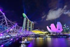 Helix bridge to Marina Bay Hotel Royalty Free Stock Photo