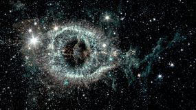 The Helix nebula. A cosmic starlet eerie resemblance to a giant eye on a background of a colorful universe, collage. Elements of this image furnished by NASA stock image