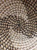 Helix textures of waved staw basket Royalty Free Stock Photos