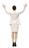 Hellång backview av affärskvinnan med händer upp arkivfoton