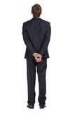 Hellång stående av affärsmannen med bundna händer arkivbild