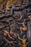 Hell depiction on a carved wooden piece. Stock Photography