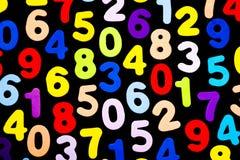 Hell farbige Zahlen auf schwarzem Hintergrund Lizenzfreie Stockbilder